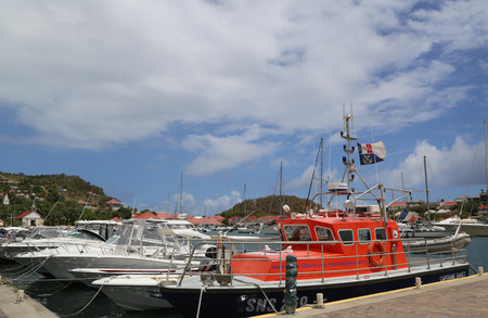 rescue west: ST BARTS, FRENCH WEST INDIES - June 12, 2015: National rescue company boat at Gustavia Harbor in St Barts. The island is popular tourist destination during the winter holiday season