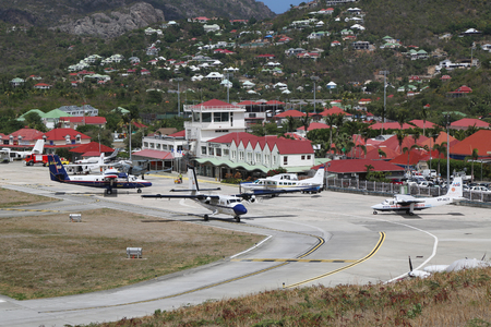 shortest: ST. BARTS, FRENCH WEST INDIES - JUNE 11, 2015: Gustaf III Airport also known as Saint Barthelemy Airport. At 2,133 ft its runway is one of the shortest in the world.