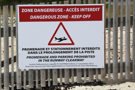 collectivity: Airport danger sign at St Barts, French West Indies Stock Photo
