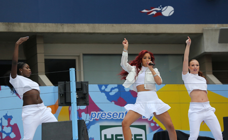 grand kids: NEW YORK - AUGUST 29, 2015: Recording artist Natalie La Rose performs during Arthur Ashe Kids Day 2015 at Billie Jean King National Tennis Center in New York Editorial