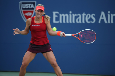 backhand: NEW YORK - SEPTEMBER 5, 2015: Professional tennis player Angelique Kerber of Germany in action during US Open 2015 third round match at Arthur Ashe Stadium