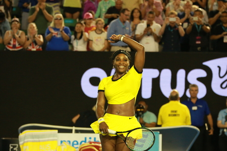racket stadium: MELBOURNE, AUSTRALIA - JANUARY 28, 2016: Twenty one times Grand Slam champion Serena Williams celebrates victory after her semifinal match at Australian Open 2016  in Melbourne Park