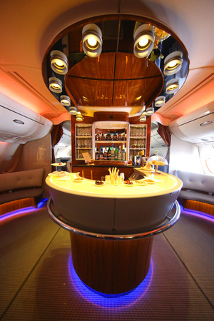 lounge: DUBAI, UAE - FEBRUARY 7, 2016: Emirates Airbus A380 in flight cocktail bar and lounge. Emirates is one of two flag carriers of the United Arab Emirates along with Etihad Airways and is based in Dubai