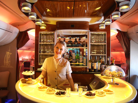 dubai flag: DUBAI, UAE - FEBRUARY 7, 2016: Emirates Airbus A380 in flight cocktail bar and lounge. Emirates is one of two flag carriers of the United Arab Emirates along with Etihad Airways and is based in Dubai