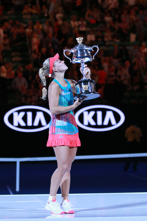 grand slam: MELBOURNE, AUSTRALIA - JANUARY 30, 2016: Grand Slam champion Angelique Kerber of Germany holding Australian Open trophy during trophy presentation after victory at Australian Open 2016 in Melbourne