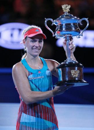 racket stadium: MELBOURNE, AUSTRALIA - JANUARY 30, 2016: Grand Slam champion Angelique Kerber of Germany holding Australian Open trophy during trophy presentation after victory at Australian Open 2016 in Melbourne