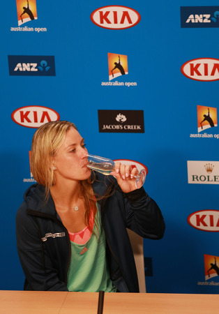 racket stadium: MELBOURNE, AUSTRALIA - JANUARY 30, 2016:Grand Slam champion Angelique Kerber of Germany celebrates victory during press conference at Australian Open 2016 at Australian tennis center in Melbourne Park