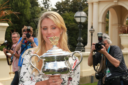 racket stadium: MELBOURNE, AUSTRALIA - JANUARY 31, 2016:Grand Slam champion Angelique Kerber of Germany surrounded by journalists and photographers during Australian Open 2016 victory celebration at Government House Editorial