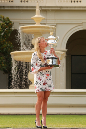 grand slam: MELBOURNE, AUSTRALIA - JANUARY 31, 2016: Grand Slam champion Angelique Kerber of Germany posing in Government House with championship trophy after victory at Australian Open 2016 in Melbourne