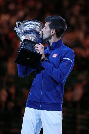 grand slam: MELBOURNE, AUSTRALIA - JANUARY 31, 2016: Grand Slam champion Novak Djokovic of Sebia holding Australian Open trophy during trophy presentation after victory at Australian Open 2016 in Melbourne Park Editorial