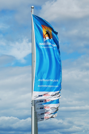 annually: MELBOURNE, AUSTRALIA - JANUARY 31, 2016: Flags with Australian Open logo waving in the wind. The Australian Open is a major tennis tournament held annually in Melbourne, Australia Editorial