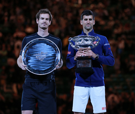 finalist: MELBOURNE, AUSTRALIA - JANUARY 31, 2016: Australian Open 2016 finalist Andy Murray L and Grand Slam champion Novak Djokovic of Serbia during trophy presentation after final match in Melbourne Park Editorial