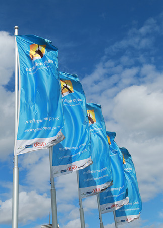 racket stadium: MELBOURNE, AUSTRALIA - JANUARY 31, 2016: Flags with Australian Open logo waving in the wind. The Australian Open is a major tennis tournament held annually in Melbourne, Australia Editorial