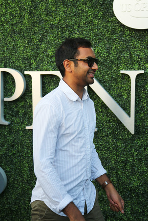 comedian: NEW YORK - SEPTEMBER 8, 2015: Comedian Aziz Ansari attends US Open 2015 tennis match between Serena and Venus Williams at USTA Billie Jean King National Tennis Center in New York