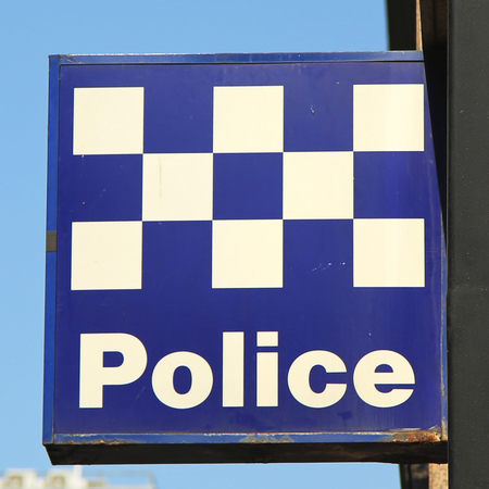 federal police: MELBOURNE, AUSTRALIA - JANUARY 24, 2016: Australian Police Sign in Melbourne. In Australia there are two distinct levels of police force, the state police forces and the Australian Federal Police Editorial
