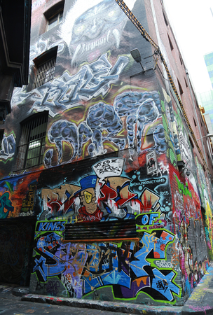 youth crime: MELBOURNE, AUSTRALIA - JANUARY 28, 2016: Hosier lane street art is one of the major tourists attraction in Melbourne. Hosier lane is famous for its street graffiti arts made by local artists.