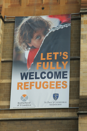 MELBOURNE, AUSTRALIA - JANUARY 25, 2016: Lets fully welcome refugees banner on St. Paul s Cathedral in Downtown Melbourne