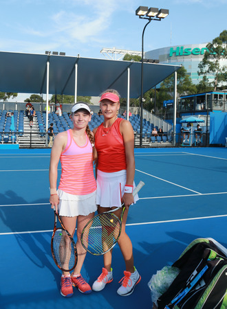racket stadium: MELBOURNE, AUSTRALIA - JANUARY 27, 2016:  Junior tennis players Anastasia Zarytska L and Dayana Yastremska of Ukraine after doubles semifinal match victory  at Australian Open 2016 in Melbourne Park