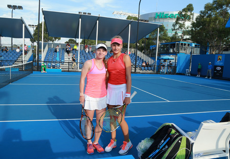 doubles: MELBOURNE, AUSTRALIA - JANUARY 27, 2016:  Junior tennis players Anastasia Zarytska L and Dayana Yastremska of Ukraine after doubles semifinal match victory  at Australian Open 2016 in Melbourne Park