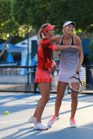 doubles: MELBOURNE, AUSTRALIA - JANUARY 30, 2016: Junior tennis players Teresa Mihalikova of Slovakia (L) and Anna Kalinskaya of Russia celebrate victory after doubles final match at Australian Open 2016