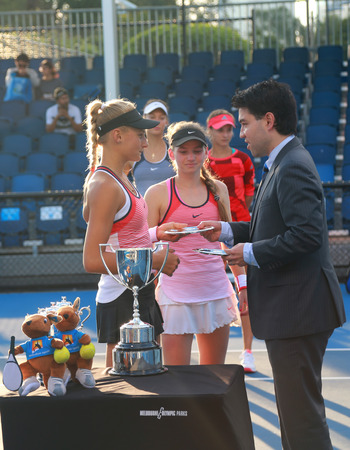 doubles: MELBOURNE, AUSTRALIA - JANUARY 30, 2016: Junior tennis players Anastasia Zarytska L and Dayana Yastremska of Ukraine during trophy presentation after  doubles final match at Australian Open 2016 Editorial
