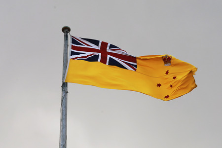 governor: MELBOURNE, AUSTRALIA - JANUARY 31, 2016: The flag of the Governor of Victoria raised over the belvedere tower of Government House, Melbourne