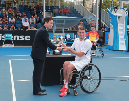 finalist: MELBOURNE, AUSTRALIA - JANUARY 30, 2016: Grand Slam finalist Joachim Gerard of Belgium posing with trophy after Australian Open 2016 wheelchair singles final match in Melbourne Park