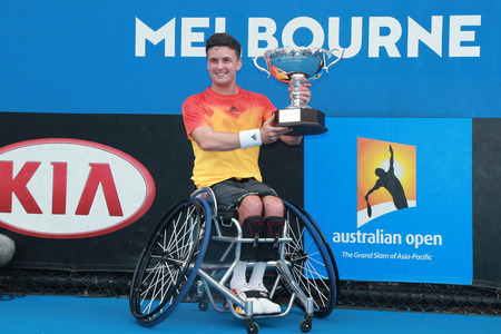 grand slam: MELBOURNE, AUSTRALIA - JANUARY 30, 2016: Grand Slam champion Gordon Reid of Great Britain posing with trophy after Australian Open 2016 wheelchair singles final match in Melbourne Park