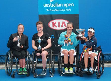 yui: MELBOURNE, AUSTRALIA - JANUARY 30, 2016: Jiske Griffioen L NED ,Aniek Van Koot NED, Marjolein Buis NED and Yui Kamiji JAP after Australian Open 2016 women s wheelchair doubles final match