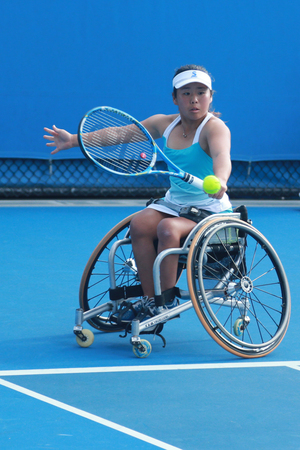 racket stadium: MELBOURNE, AUSTRALIA - JANUARY 30, 2016: Grand Slam champion Yui Kamiji of Japan in action during Australian Open 2016 women s wheelchair doubles final match in Melbourne Park Editorial