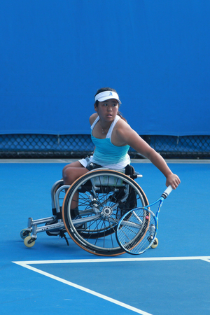 yui: MELBOURNE, AUSTRALIA - JANUARY 30, 2016: Grand Slam champion Yui Kamiji of Japan in action during Australian Open 2016 women s wheelchair doubles final match in Melbourne Park Editorial