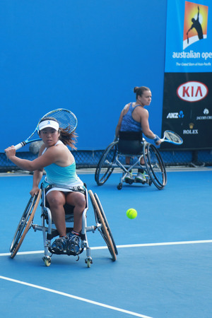 30 s: MELBOURNE, AUSTRALIA - JANUARY 30, 2016: Grand Slam champion Yui Kamiji of Japan in action during Australian Open 2016 women s wheelchair doubles final match in Melbourne Park Editorial