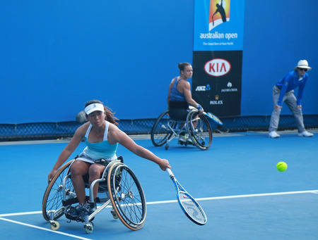 doubles: MELBOURNE, AUSTRALIA - JANUARY 30, 2016: Grand Slam champion Yui Kamiji of Japan in action during Australian Open 2016 women s wheelchair doubles final match in Melbourne Park Editorial