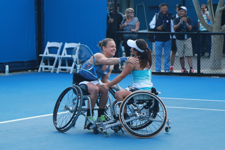 doubles: MELBOURNE, AUSTRALIA - JANUARY 30, 2016:Marjolein Buis of Netherlands L and Yui Kamiji of Japan celebrates victory after Australian Open 2016 women s wheelchair doubles final match in Melbourne Park