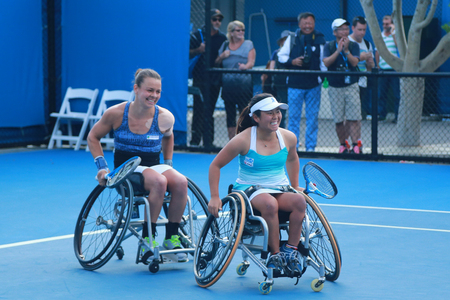30 s: MELBOURNE, AUSTRALIA - JANUARY 30, 2016:Marjolein Buis of Netherlands L and Yui Kamiji of Japan celebrates victory after Australian Open 2016 women s wheelchair doubles final match in Melbourne Park