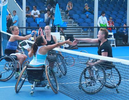 30 s: MELBOURNE, AUSTRALIA - JANUARY 30, 2016: Marjolein Buis NED L Jiske Griffioen NED ,Aniek Van Koot NED,  and Yui Kamiji JAP after Australian Open 2016 women s wheelchair doubles final match