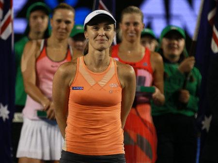 grand slam: MELBOURNE, AUSTRALIA - JANUARY 30, 2016: Grand Slam champion Martina Hingis of Switzerland during trophy presentation after doubles final match at Australian Open 2016