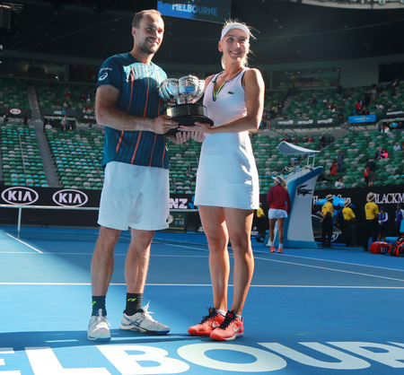 doubles: MELBOURNE, AUSTRALIA - JANUARY 31, 2016: Grand Slam champions Bruno Soares of Brazil L and Elena Vesnina of Russia during trophy presentation after mixed doubles final match at Australian Open 2016 Editorial