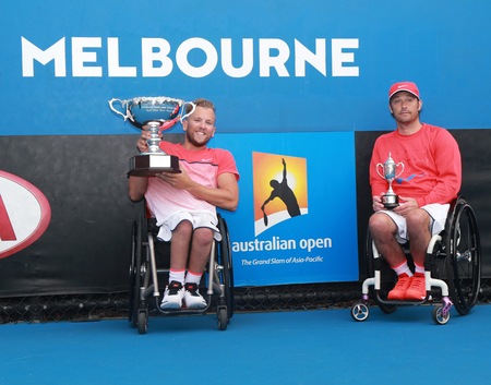 quad: MELBOURNE, AUSTRALIA - JANUARY 30, 2016: Grand Slam champion Dylan Alcott of Australia L and David Wagner of USA posing with trophy after Australian Open 2016 quad wheelchair singles final match Editorial