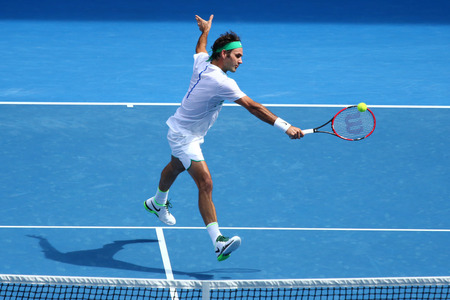 MELBOURNE, AUSTRALIA - JANUARY 26, 2016: Seventeen times Grand Slam champion Roger Federer of Switzerland in action during quarterfinal match at Australian Open 2016 in Melbourne Park