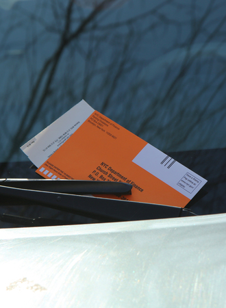 NEW YORK - MARCH 10, 2016: Illegal Parking Violation Citation On Car Windshield in New York Editorial
