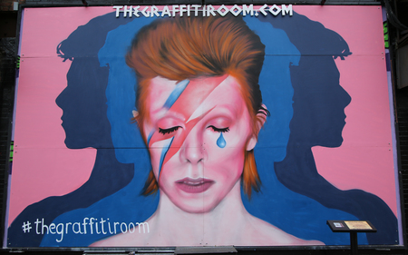 NEW YORK - MARCH 10, 2016: Mural in memory of David Bowie in Little Italy in Manhattan.David Robert Jones, known as David Bowie, was an English singer, songwriter, actor and record producer