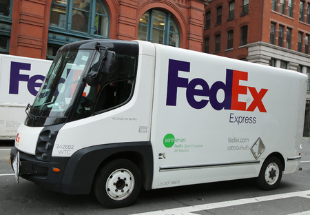 NEW YORK - MARCH 10, 2016: Earthsmart FedEx zero emission all electrical truck in Lower Manhattan. The Nissan e-NV200 added to the delivery fleet as a part of the FedEx EarthSmart program Editorial