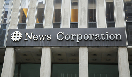 american media: NEW YORK - MARCH 10, 2016: News Corporation headquarters building  in New York City. News Corporation is an American diversified multinational mass media corporation. Editorial