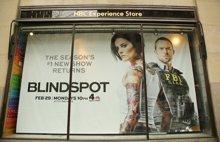 tonight: NEW YORK - MARCH 10, 2016: NBC Experience Store window display decorated with Blindspot television event logo in Rockefeller Center in Midtown Manhattan Editorial