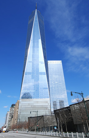 world trade: NEW YORK - MARCH 6, 2016: Freedom Tower in Lower Manhattan. One World Trade Center is the tallest building in the Western Hemisphere and the third-tallest building in the world