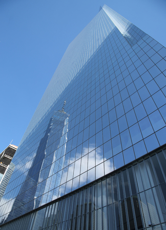 9 11: NEW YORK - MARCH 6, 2016: World Trade Center 4 with reflection from Freedom Tower in September 11 Memorial Park