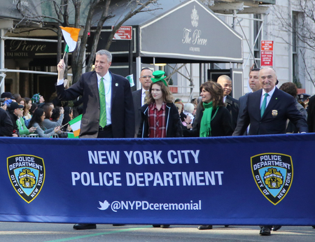 st  patrick s day: NEW YORK - MARCH 17, 2016: New Yorks mayor Bill De Blasio (L) and Police Commissioner William Bratton marching at the St. Patrick s Day Parade in New York.