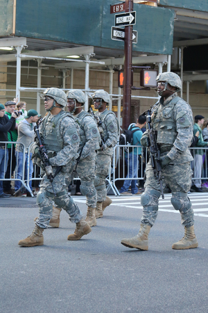 st  patrick s day: NEW YORK - MARCH 17, 2016: US Special Forces members marching at the St. Patrick s Day Parade in New York. Editorial