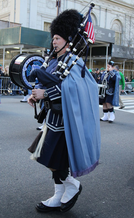st  patrick s: NEW YORK - MARCH 17, 2016: Bagpiper from Police Pipes and Drums of Bergen County marching at the St. Patrick s Day Parade in New York. Editorial